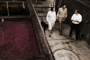Allister, Richard Langford (winemaker) and Cameron with open fermenters